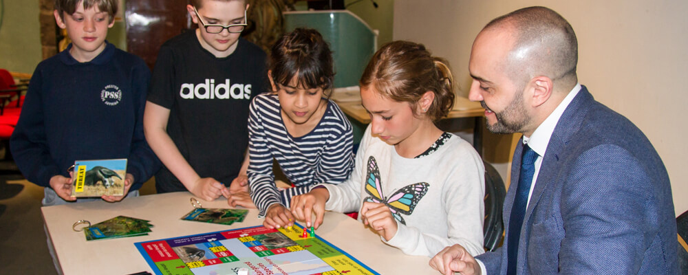 Children playing with a Science in the Language Class board game
